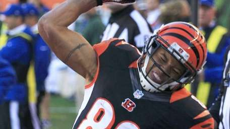 Cincinnati Bengals wide receiver Marvin Jones spikes the