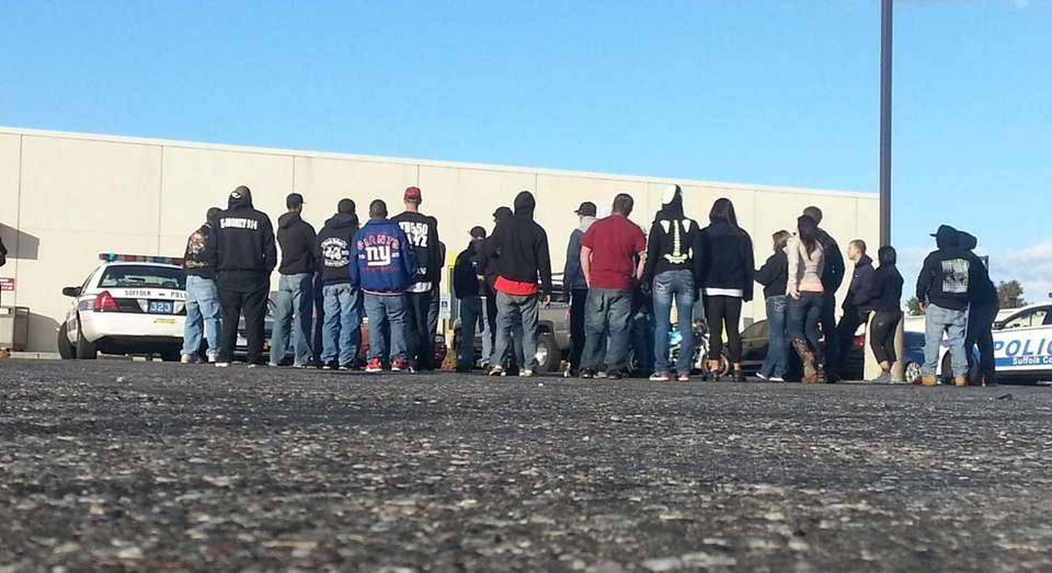 Motorcycle riders and passengers stand by as Suffolk