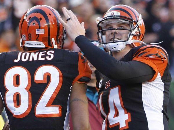 Cincinnati Bengals quarterback Andy Dalton (14) congratulates wide
