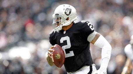 Oakland Raiders quarterback Terrelle Pryor runs with the