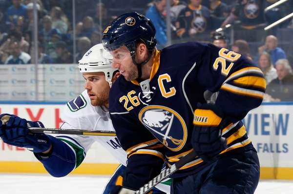 The Vancouver Canucks' Zack Kassian, left, and Thomas
