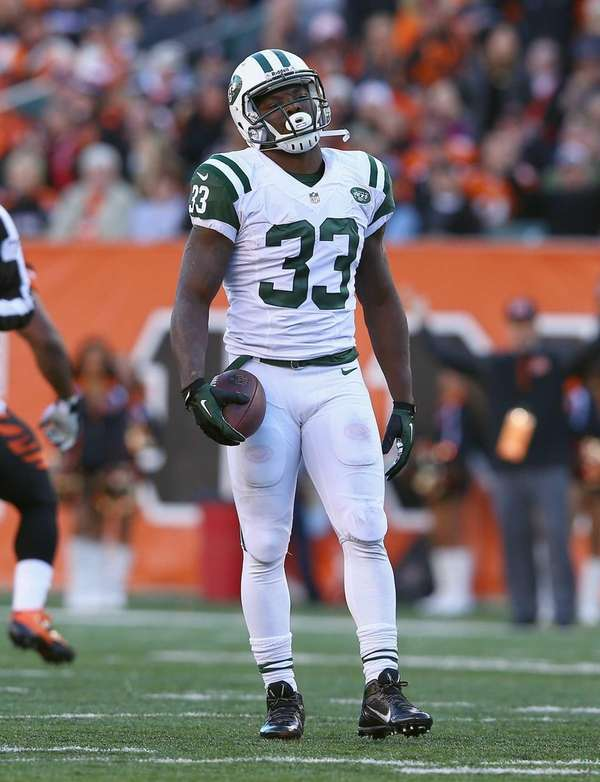 Jets running back Chris Ivory reacts after being