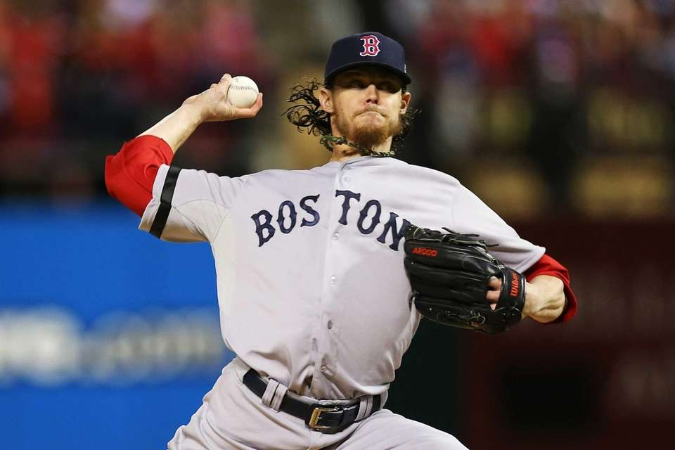Boston Red Sox pitcher Clay Buchholz throws a