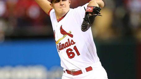 St. Louis Cardinals pitcher Seth Maness delivers a