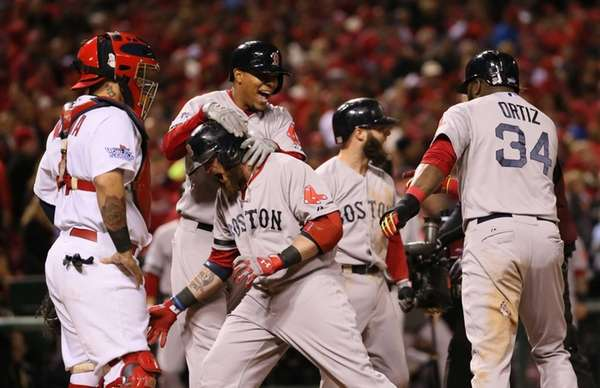 Boston Red Sox teammates congratulate Jonny Gomes after