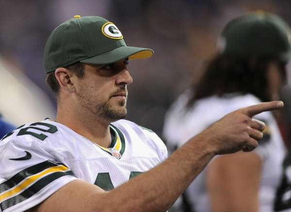 Green Bay Packers quarterback Aaron Rodgers looks on