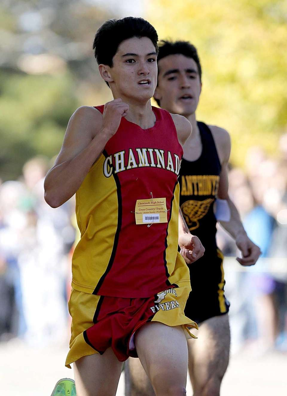 Chaminade's Sean Kelly overtakes St. Anthony's Louis Santelli