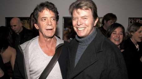 Lou Reed, left, and David Bowie attend the