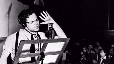 Orson Welles reads from his script in the