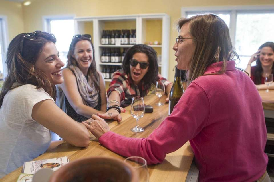 Coffee Pot Cellars co-owner Laura Klahre, right, shares