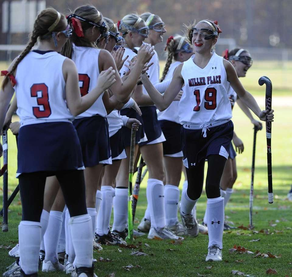 Miller Place's Ariana Esposito high-fives her teammates before