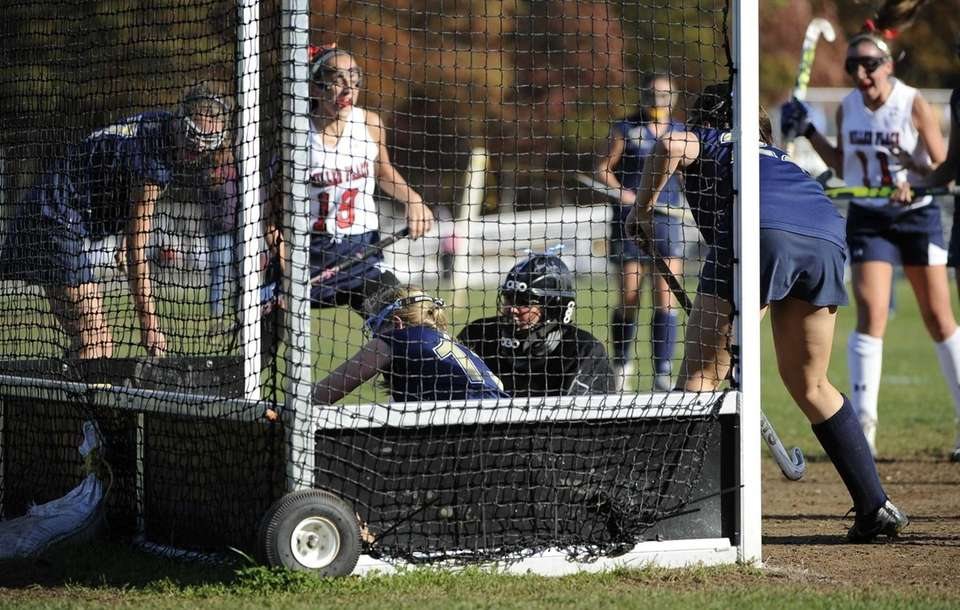 Miller Place's Ariana Esposito (#19) watches her goal