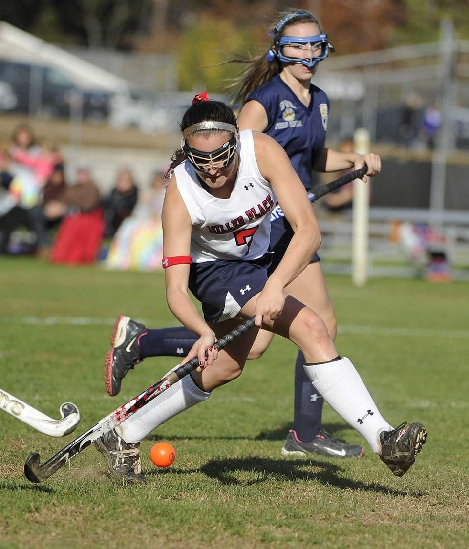 Miller Place's Ally Hutzler strikes the ball to