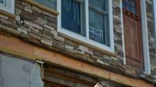 Lisa Mentges sits outside her home in Long
