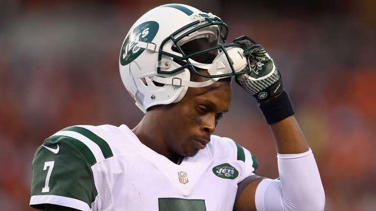 Geno Smith walks off of the field in