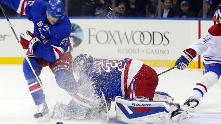 Henrik Lundqvist is sprayed with ice from teammate