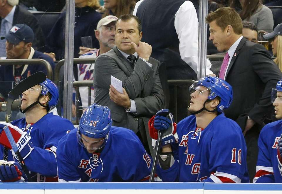 Alain Vigneault looks on during a break in