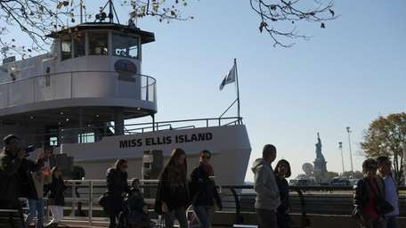 Tourists arrive for the re-opening Ellis Islands island's