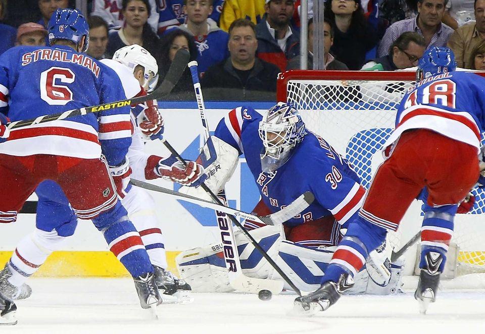 The Montreal Canadiens' Tomas Plekanec breaks toward Henrik