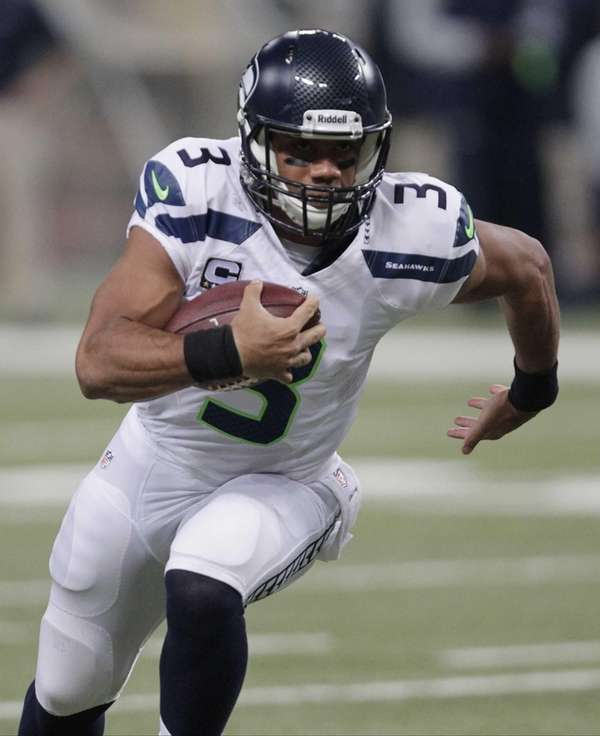 Seattle Seahawks quarterback Russell Wilson (3) rushes against