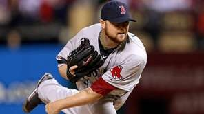 Boston Red Sox pitcher Jon Lester delivers a