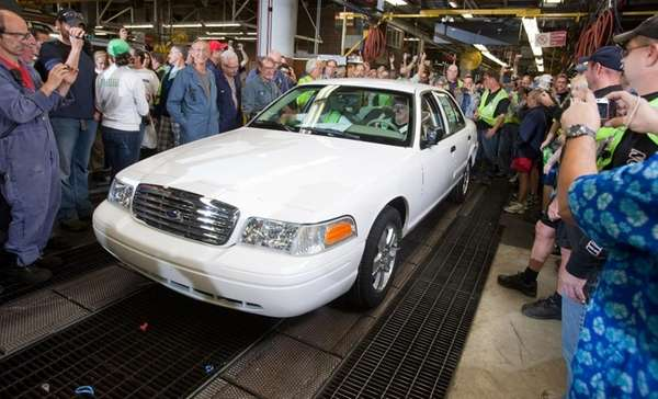 Employees gather around as the last Ford Crown