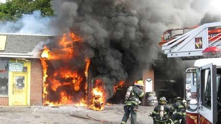 Emergency personnel respond to a fire at the