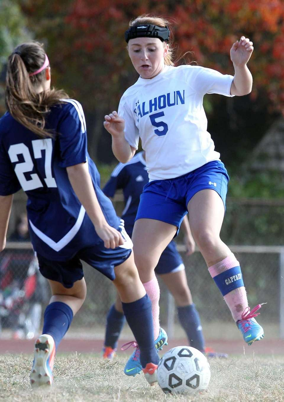 Calhoun's Jessica Foley goes for ball against JFK's