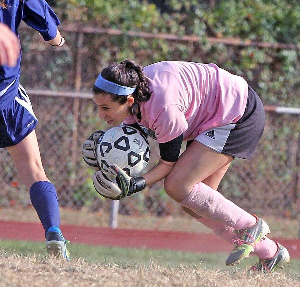 Calhoun goalie Alexandra Marcello recovers the ball after