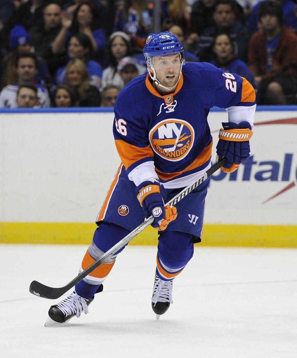 Thomas Vanek follows the action on the ice