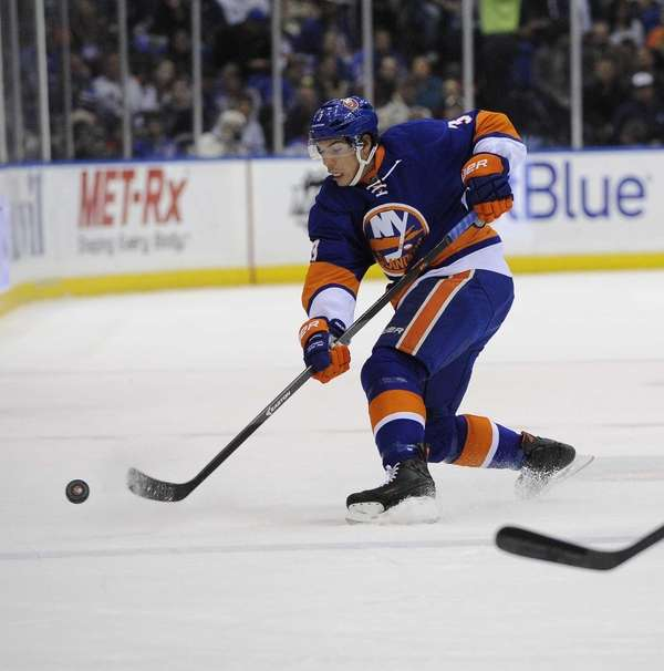 Travis Hamonic passes the puck in the first