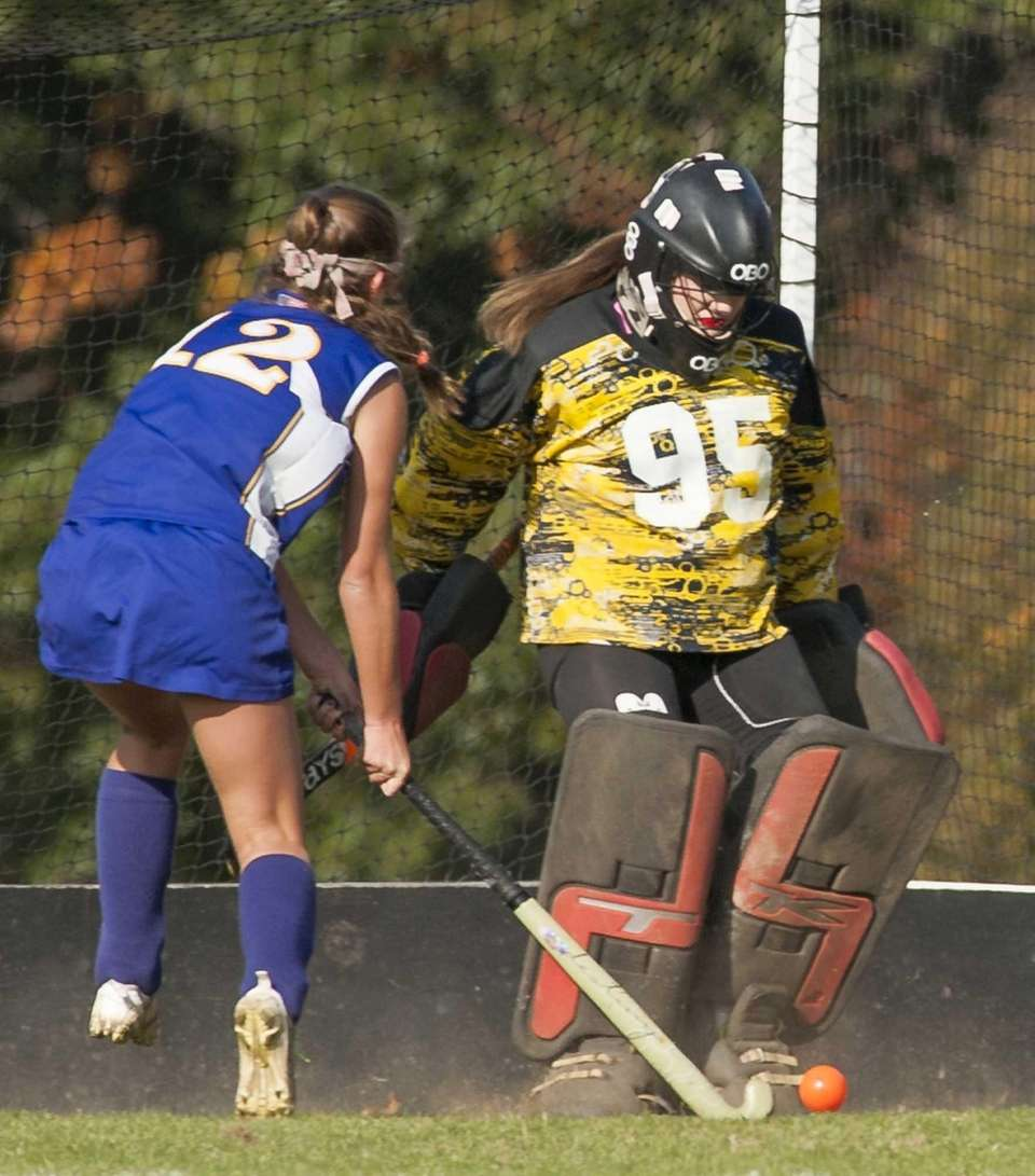 Friends Academy goalkeeper Charlotte Gelfand, right, makes a