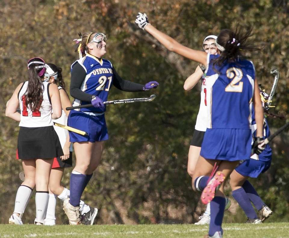 Oyster Bay's Hannah Kaiser, left, celebrates after scoring