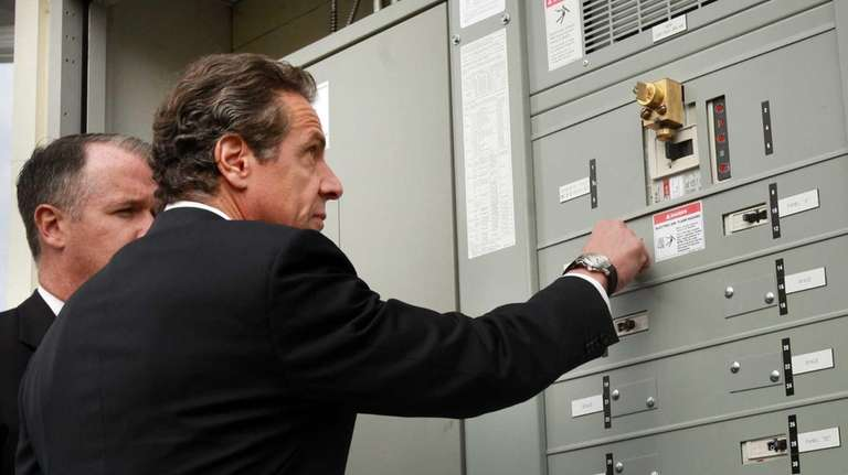 Gov. Andrew Cuomo flips a transfer switch at