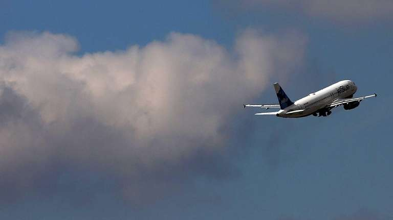 A plane takes off at Kennedy Airport in