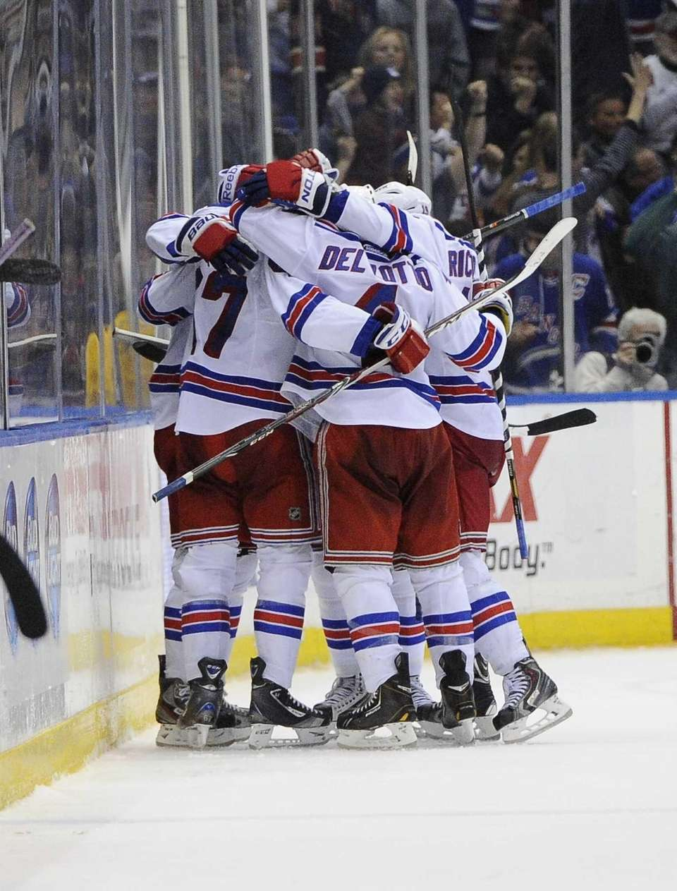The Rangers celebrate the game-winning goal by Benoit