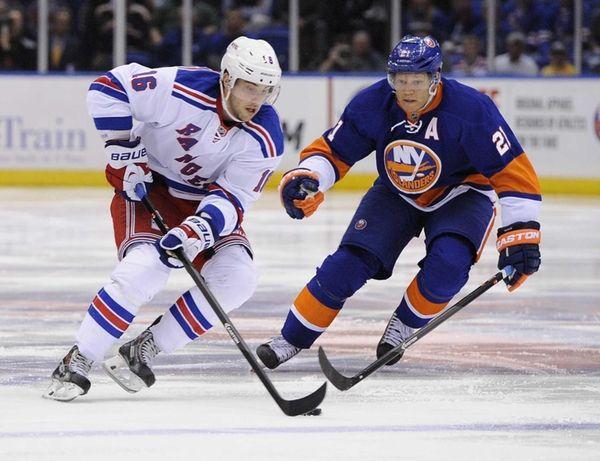 Islanders' Kyle Okposo defends against Rangers' Derick Brassard