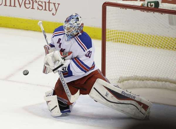 Cam Talbot (33) stops a shot on goal