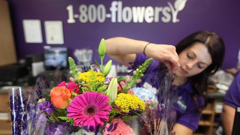 Store manager Lauren Ceglio wraps a floral arrangement