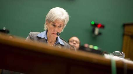 Health and Human Services Secretary Kathleen Sebelius pauses