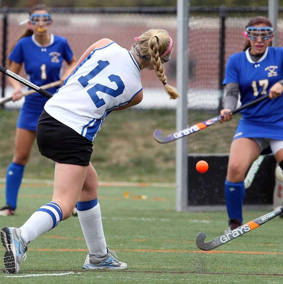 Port Washington's Carolyn Rybecky shoots on goal during