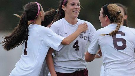 Garden City midfielder Haley O'Hanlon, center, gets congratulated