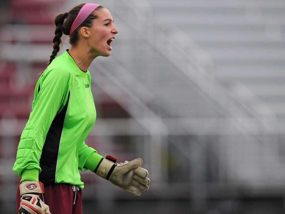 Garden City goalie Taylor Carpentier communicates with her