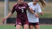 Clarke's Samantha Goodwin, left, gets pressured by Garden