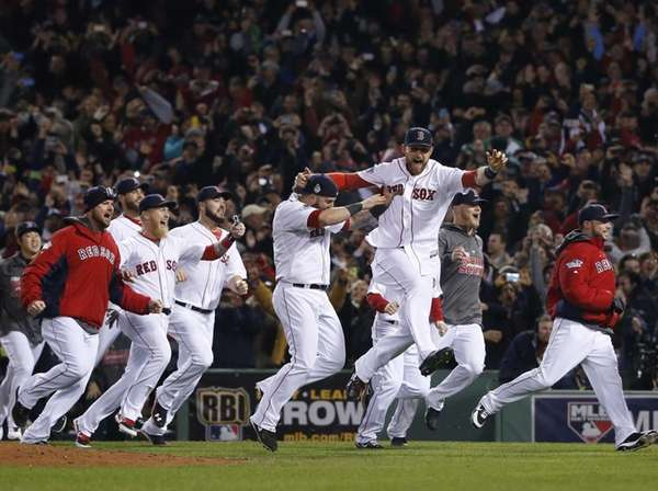 Boston Red Sox players run onto the field