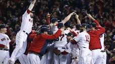 Boston Red Sox players celebrate after defeating the
