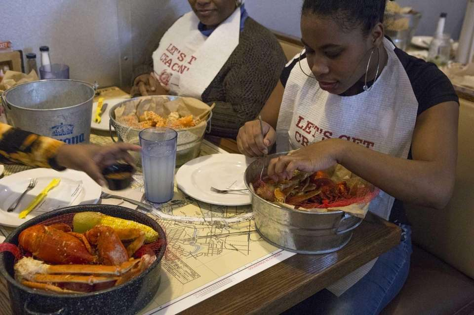 Merci Lendore of Brooklyn digs into her crab