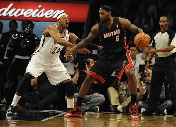 Nets' Paul Pierce guards Miami Heat's LeBron James
