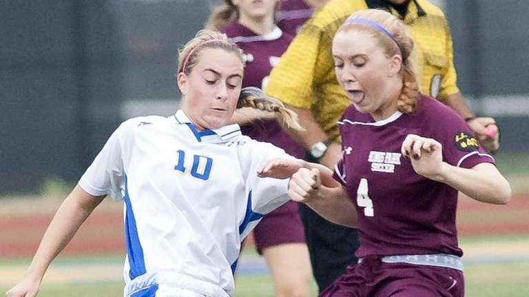 West Islip's Shannen Gillespie, left, goes after a
