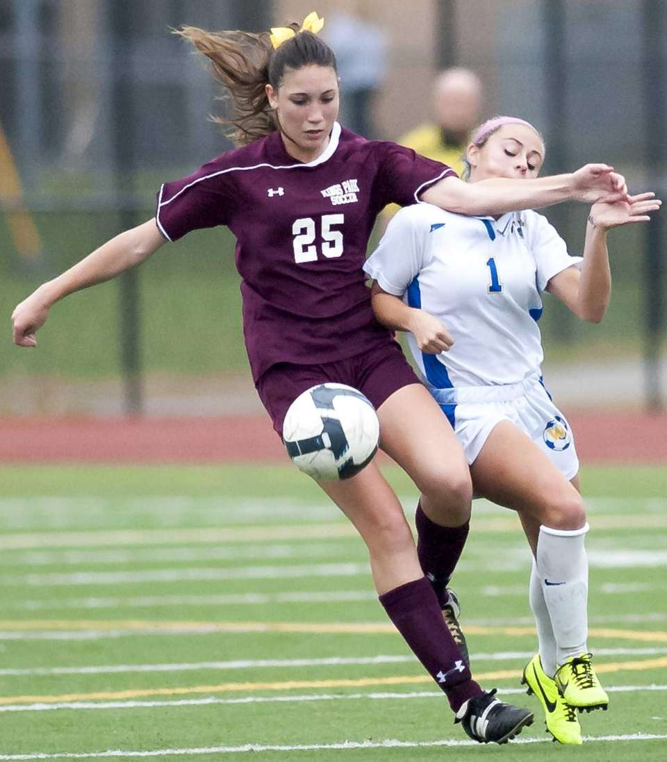 West Islip's Kylie Walsh, right, runs into the
